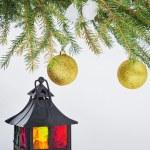 Decorative lantern and fur-tree branch with Christmas balls — Stock Photo #52995203