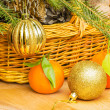 Christmas balls and tangerines on a background of a basket — Stock Photo #52995457