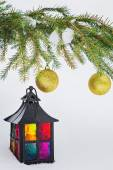 Decorative lantern and fur-tree branch with Christmas balls — Stock fotografie