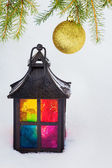 Decorative lantern  and fur-tree branch with Christmas ball — Stock fotografie