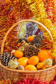 Christmas basket with fruit and a bottle of champagne — Стоковое фото
