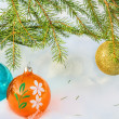 Three Christmas balls and fir branch — Stock Photo #58360443
