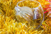 Christmas ball in a vase among tinsel — Stock Photo