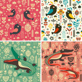 Set of floral seamless patterns with birds and crocodiles. — Stock Vector