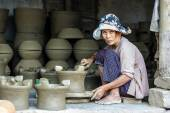 Old woman working on pottery workshop — Stock Photo
