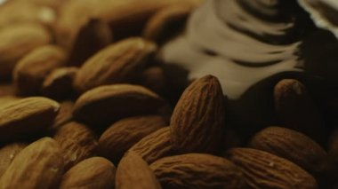 Liquid Chocolate is Covering Pile of Almonds — Stock Video