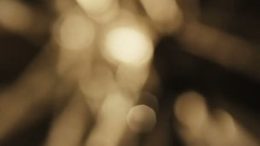 Beautiful Bokeh of Golden Rotating Lights — Stock Video