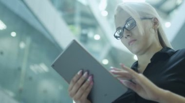 Pretty Businesswoman Using Tablet PC in Office Building — Stock Video