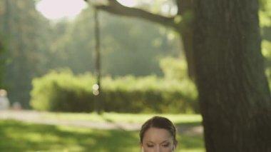 Pretty Girl Meditating in Park. Jib Shot. — Stock Video