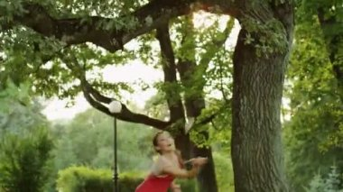 Pretty Girl Playing Badminton in Nature — Stock Video