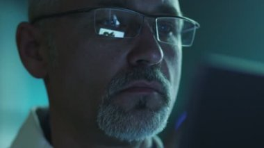 Portrait of Middle Aged Male using Tablet and Have Reflections of Screen in Glasses — Stock video