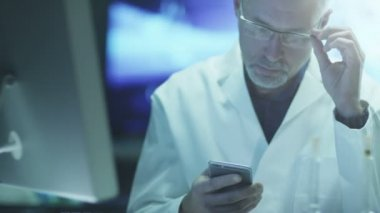 Scientist is Using Mobile Phone in Laboratory. — Stock Video