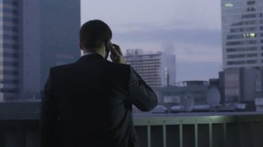 Businessman on the Phone while Being on Roof — Stock Video