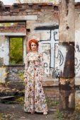 Red-head young woman near brick wall — Fotografia Stock