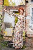 Red-head young woman near brick wall — Stok fotoğraf