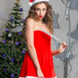 Attractive snow maiden in red dress — Stock Photo #60836445