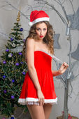 Attractive snow maiden in red dress — Stock Photo