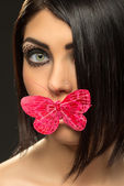 Woman with  butterfly on lips — Stock Photo