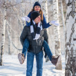 Young man piggybacking his girlfriend — Stock Photo #66508907