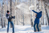 Loving couple in the winter forest. — Stock Photo