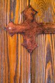 Wrought metal mount on wooden door — Stock Photo