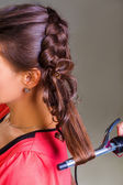 Woman curling hair — Stock Photo