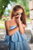 Girl with red lips and sunglasses — Stock Photo
