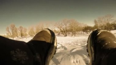 Funny winter Games - Action camera on the kid sled board — Stock Video