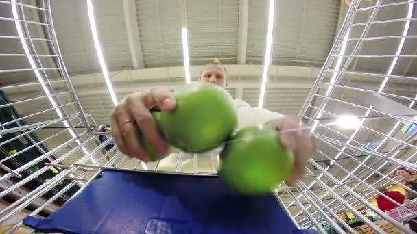Young man buying sweetie — Vidéo