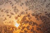 Snowflakes and ice on frozen window — Stock Photo