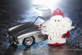 Santa Claus or Father Frost with old retro car — Stock Photo