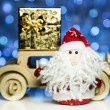 Santa Claus and old retro wooden car with gift box — Stock Photo #58918931