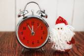 Santa Claus or Father Frost and retro alarm clock — Stock Photo