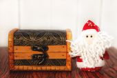 Santa Claus with wooden chest — Stock Photo