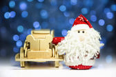 Santa Claus with old retro wooden car — Stock Photo