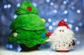 Santa Claus or Father Frost and fir tree — Stock Photo
