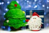Santa Claus or Father Frost with fir tree and gift box — Stock Photo