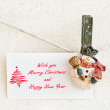 Snowman clothespins holding Christmas greeting card — Stock Photo #59662395