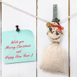 Snowman clothespin holding sack and Christmas greeting note — Stock Photo #59664571