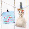 Snowman clothespin holding sack and Christmas greeting note — Stock Photo #59664585
