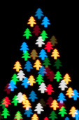 Color defocused bokeh of christmas fir-tree lights background — Stock Photo