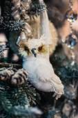 Decorative toy owl on a christmas fur-tree — Stock Photo