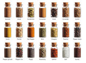 Different spices in a little bottles isolated on white backgroun — Foto Stock