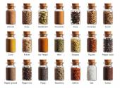 Different spices in a little bottles isolated on white backgroun — Fotografia Stock
