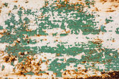 Cracked paint on rusty metal surface — Stock Photo