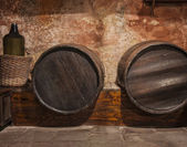 Wine cask barrels and bottle — Stock Photo