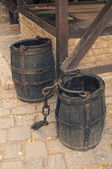 Cask barrels with chain on sett — Stock Photo
