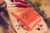 Salmon steak with herbs — Stok fotoğraf