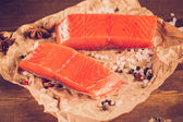 Two salmon steak on old papper — Stock Photo