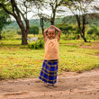 Young african girl posing in a Masai tribe village — Stock Photo #59260303